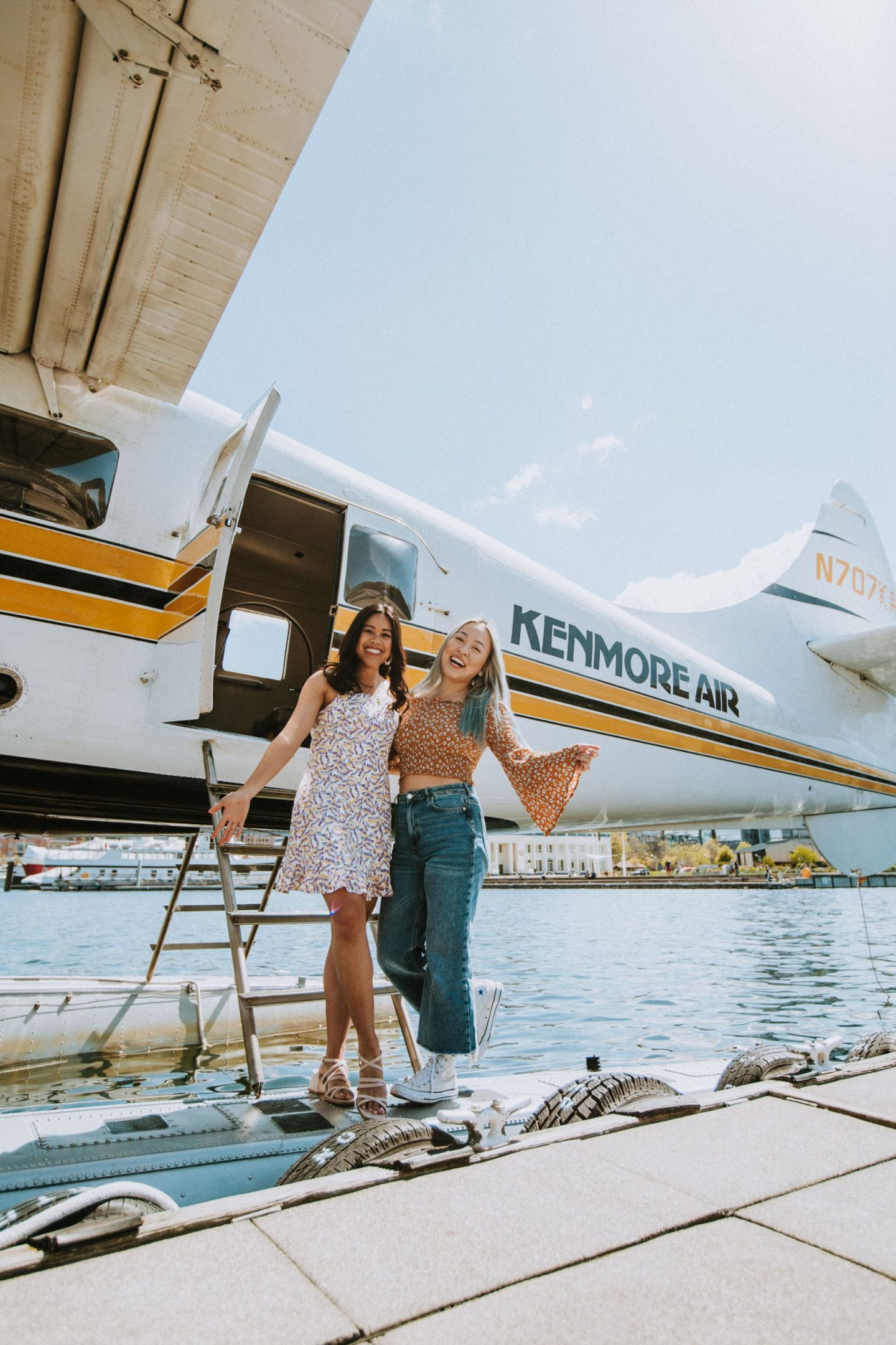 best friends in front of the seaplane