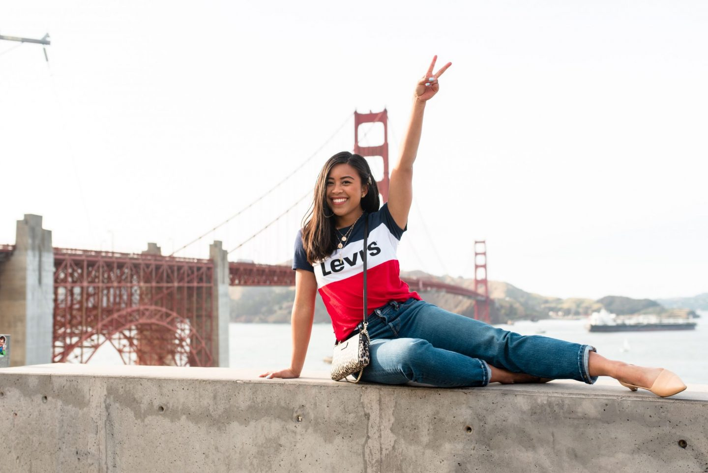 posing in front of the Golden Gate Bridge - San Francisco's Most Instagrammable Places
