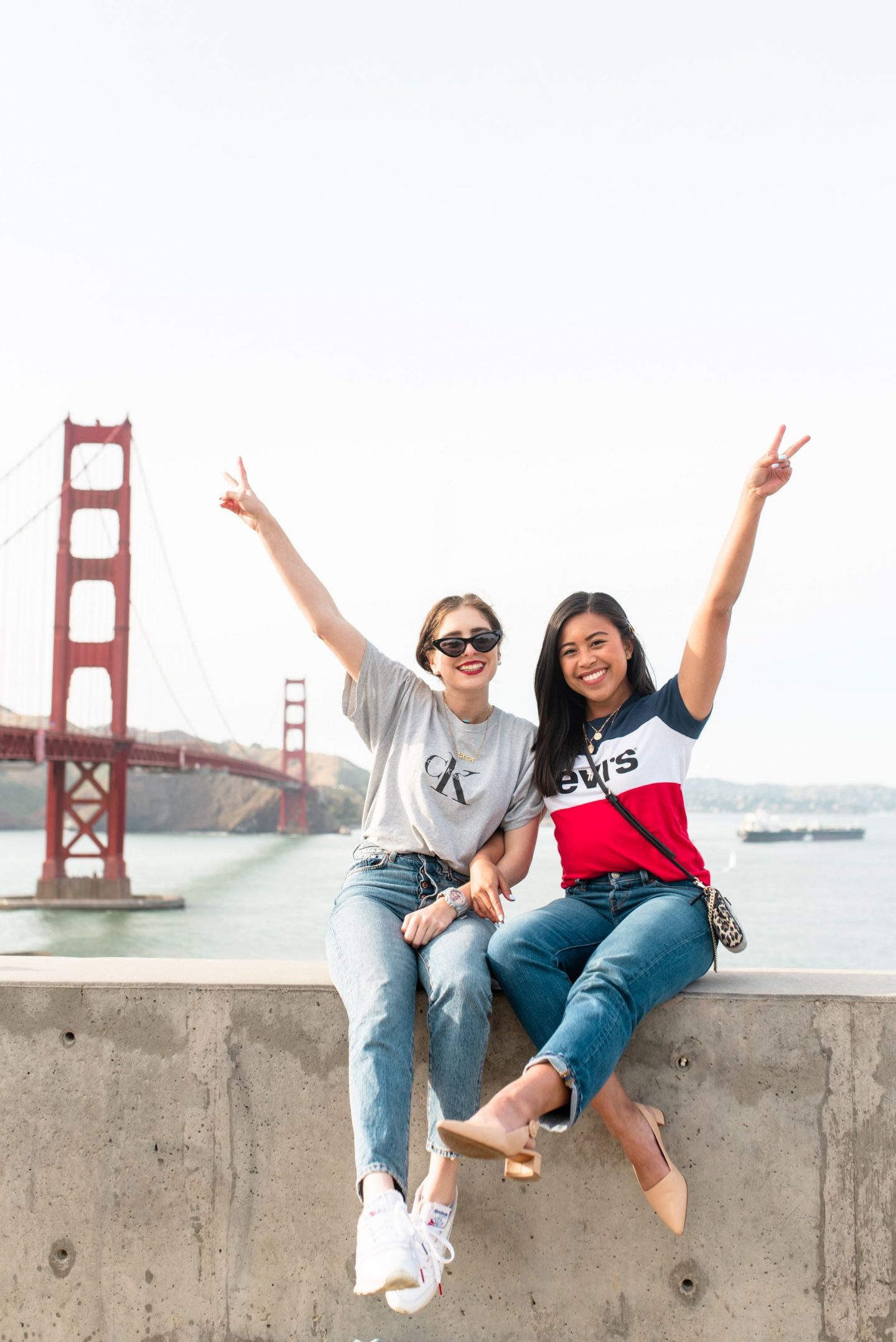 Golden Gate Bridge - Best Friends posing in front of the golden gate  - San Francisco's Most Instagrammable Places