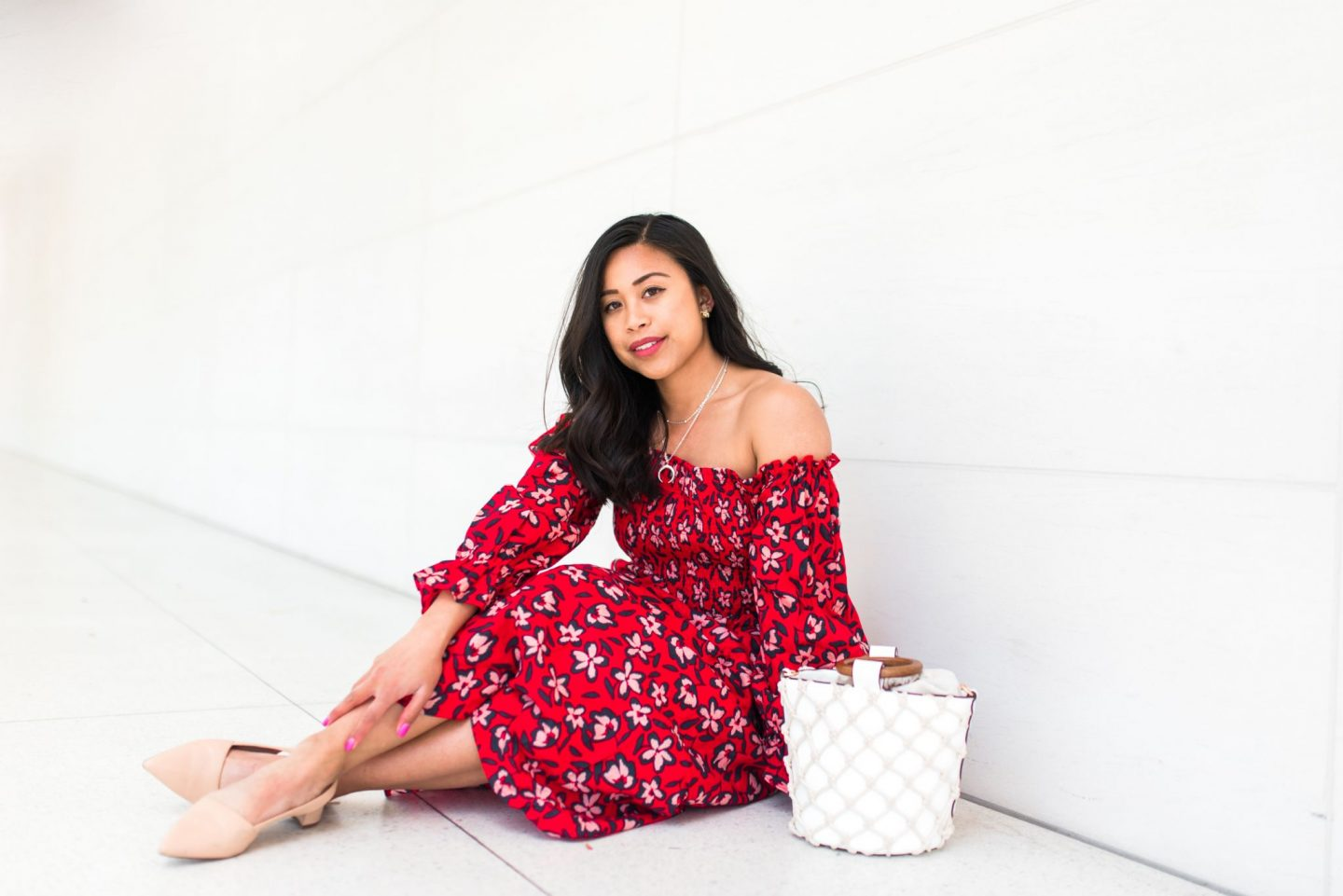 sitting down - red floral dress - spring outfit ideas