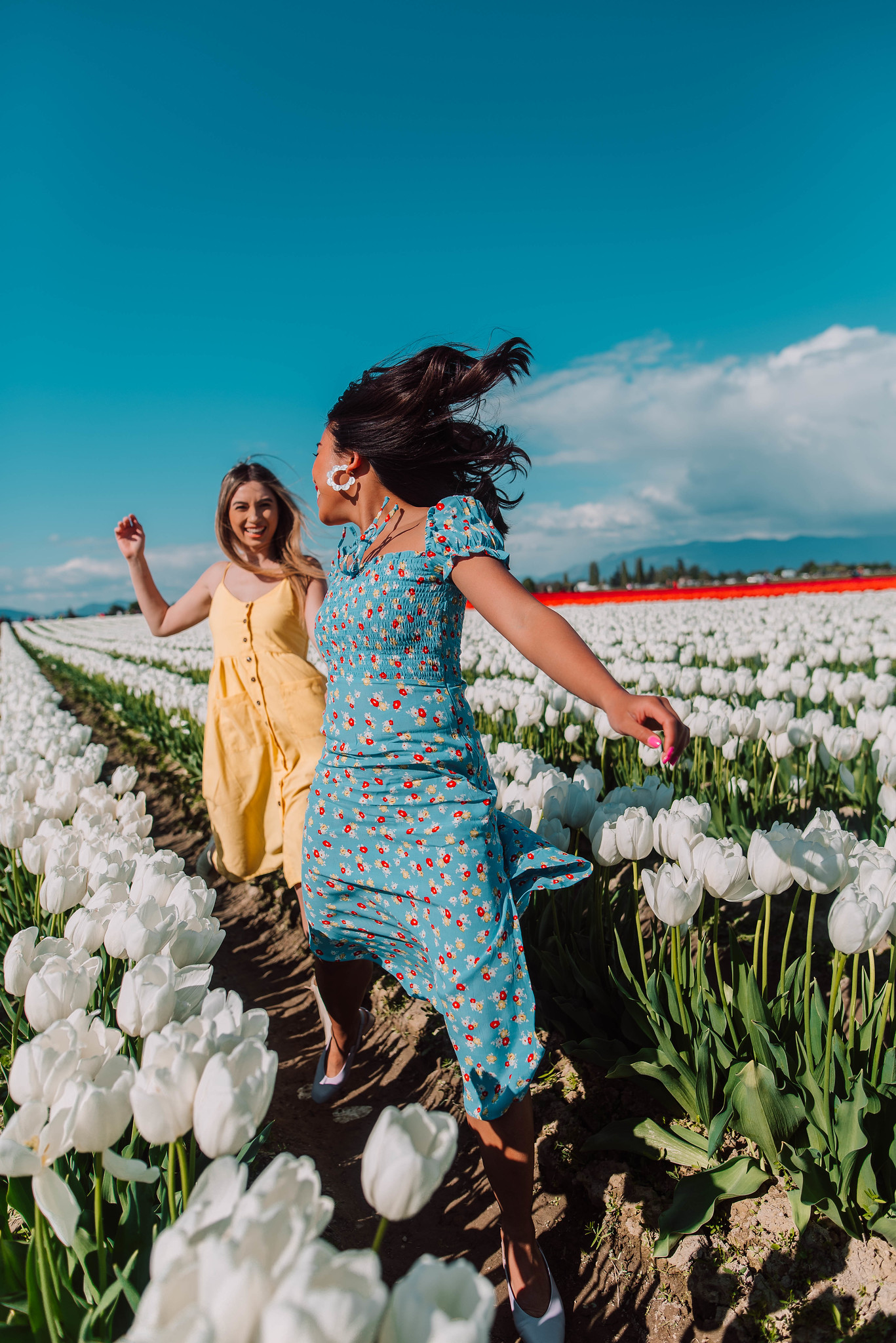 flower field photo shoot ideas - skipping through the tulip fiekd