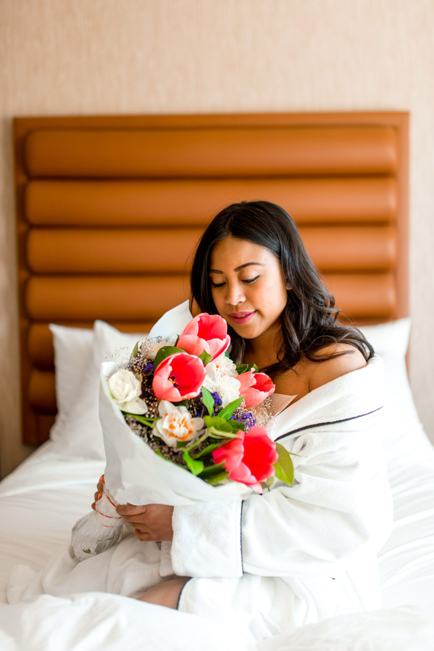 bouquet of flowers in hotel bed - emmas edition - portland hotel - dossier hotel
