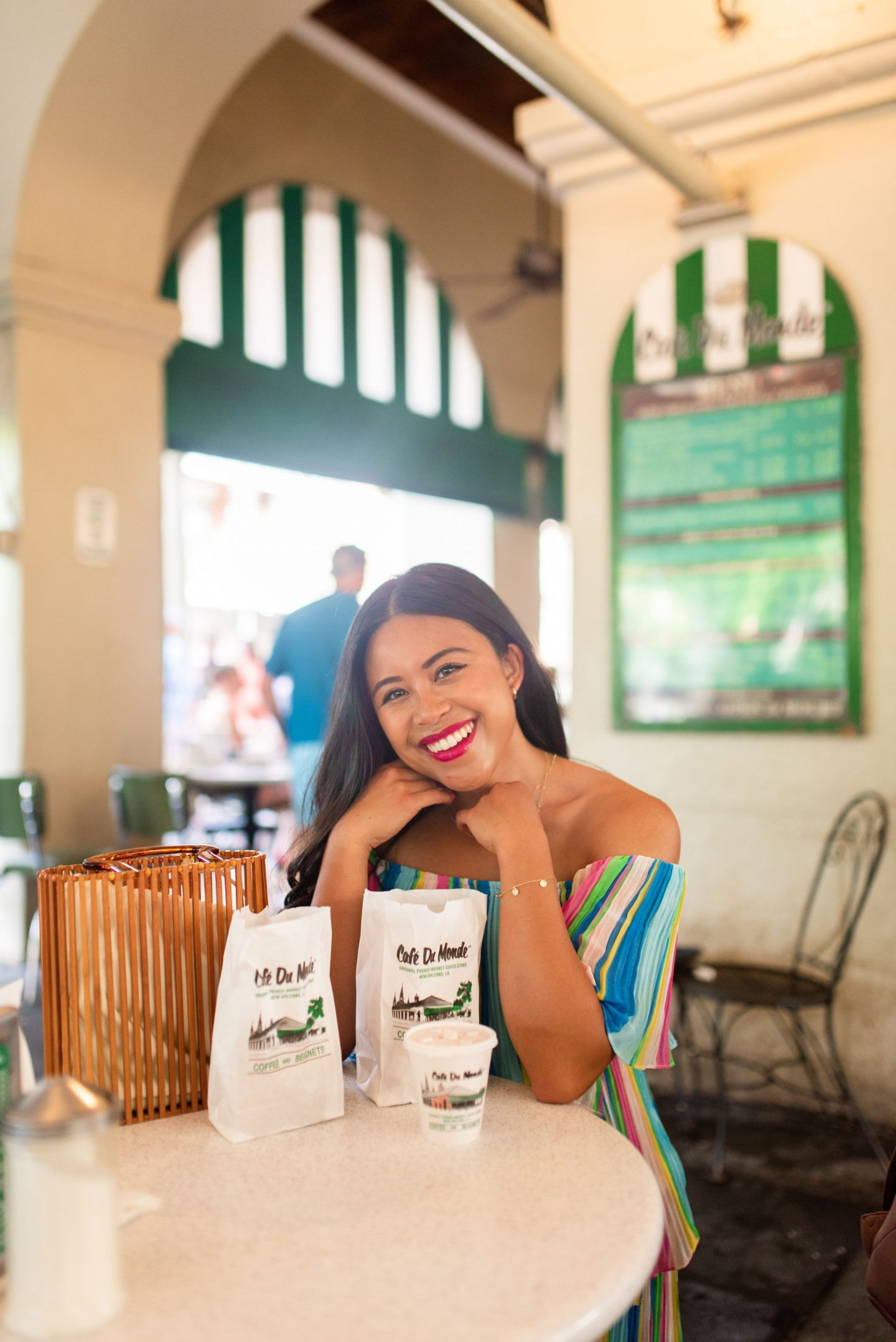 cafe du monde - Top photography spots in the French Quarter – photo locations New Orleans - Free places to take photos in New Orleans – best places to take senior photos in New Orleans – New Orleans photo shoot – French quarter photo shoot – best places to take photos in NOLA – photography spots in NOLA