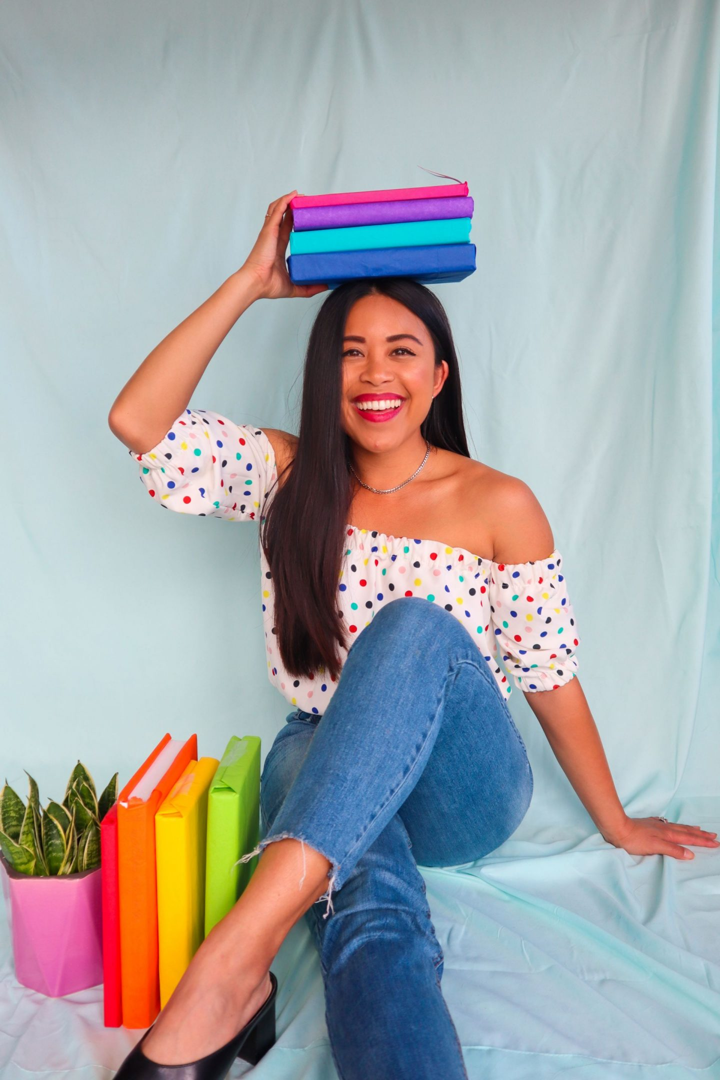 Pose with books - Creative Book Photography Ideas – book photography ideas – Instagram photo ideas – books photography Instagram – indoor photo shoot ideas – creative Instagram photos