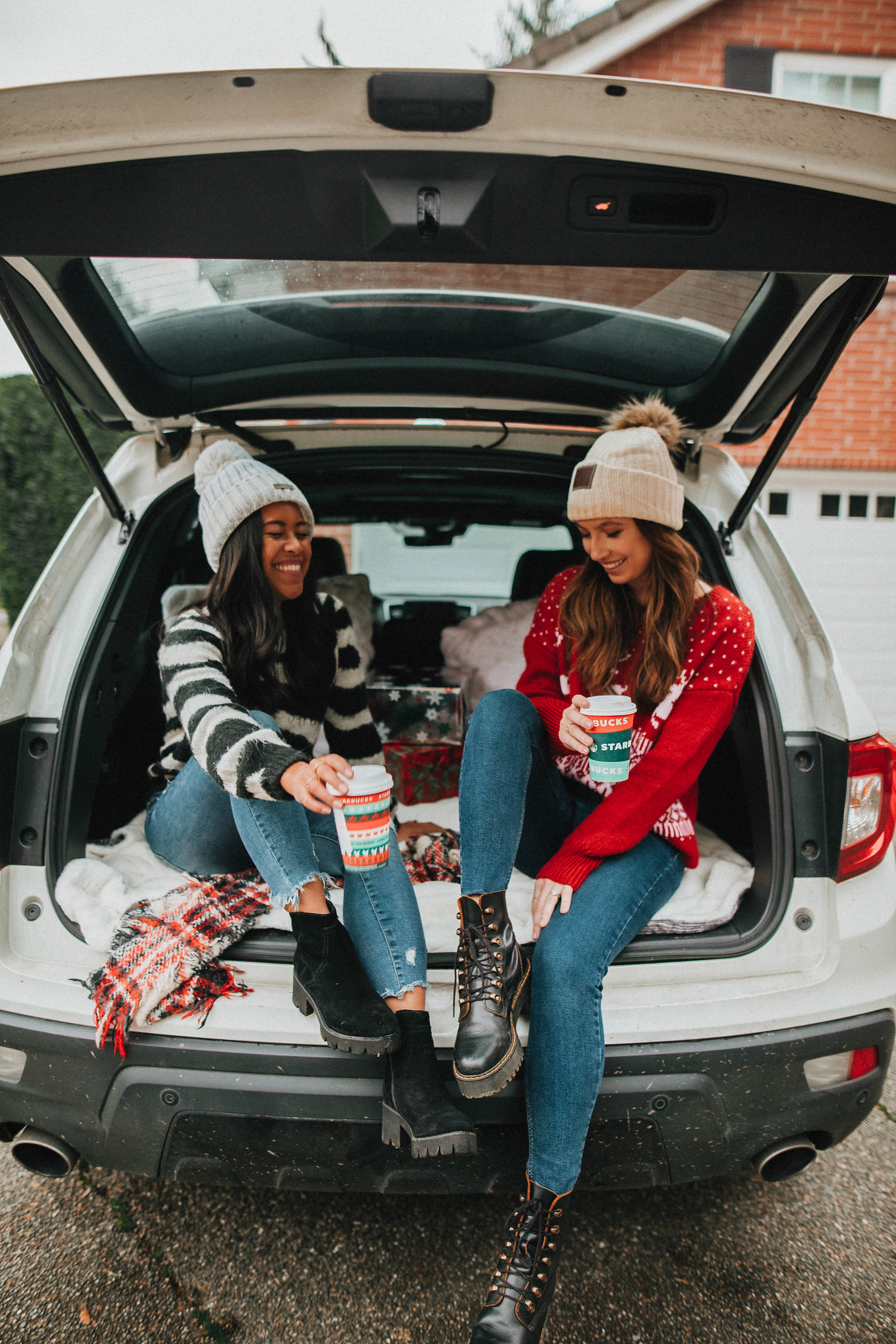 Sitting in the back of the SUV with your best friend - best friend holiday photo shoot ideas - Emma's Edition - image from www.emmasedition.com