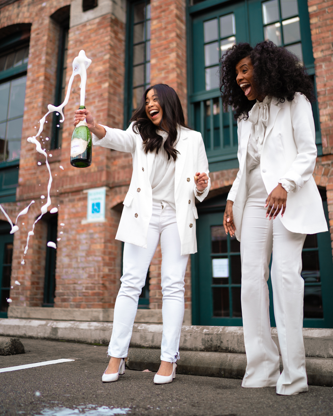 Celebration photo - champagne photo shoot ideas - Inauguration Day 2021 - Kamala Harris inspired outfit - Women in White Suits - image from www.emmasedition.com - copyright @emmasedition