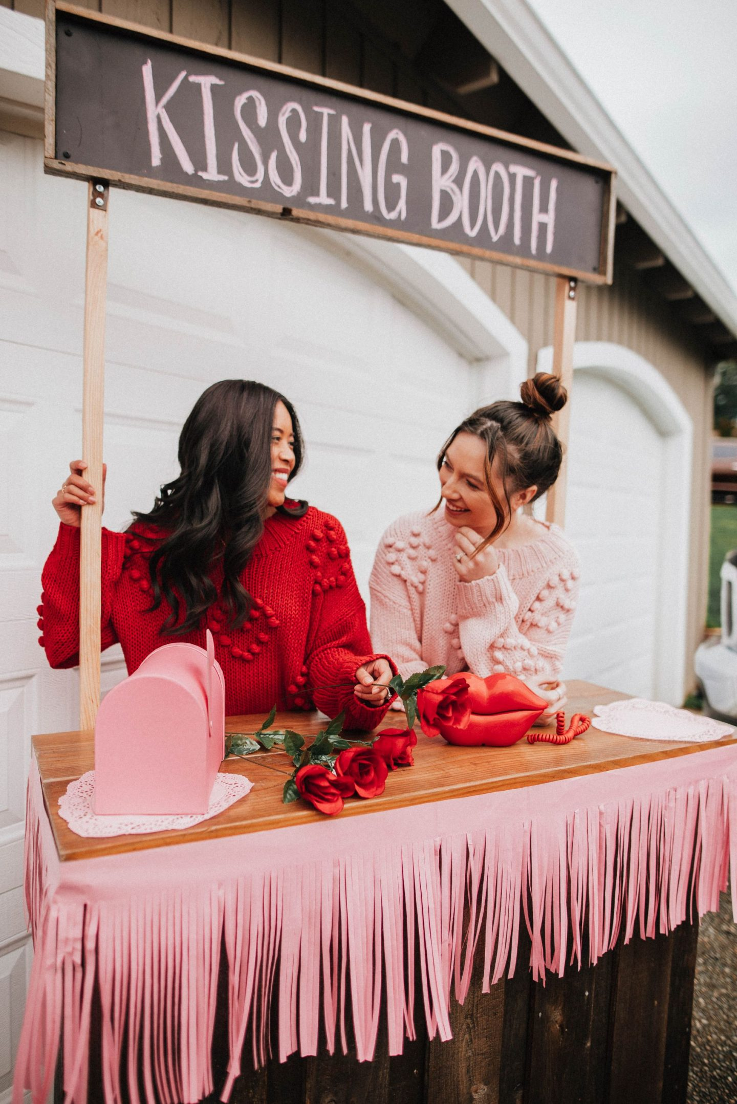 Valentine's Day posing ideas kissing booth - kissing booth photo shoot ideas - Galentine's Day photo shoot ideas - Galentine's Day poses - Galentines Day celebration - image from www.emmasedition.com - copyright @emmasedition