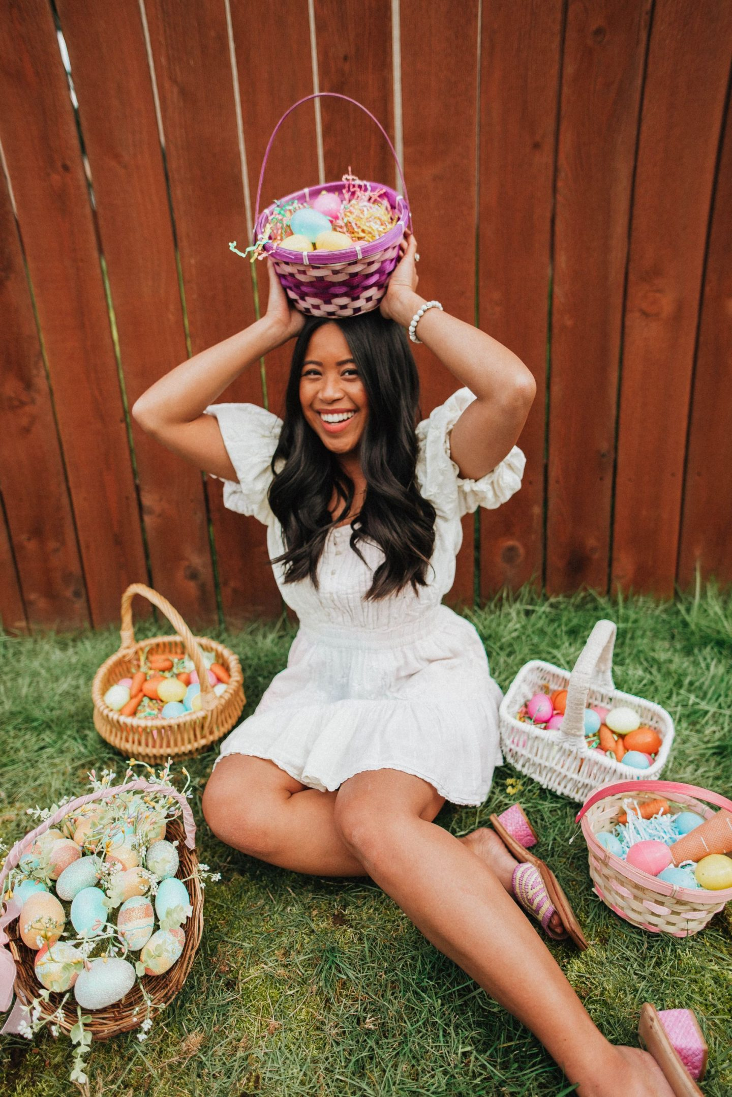 Sitting around Easter baskets - Easter baskets - Easter egg hunt - Easter photo shoot ideas - Easter dresses - Easter outfits - image from www.emmasedition - copyright @emmasedition