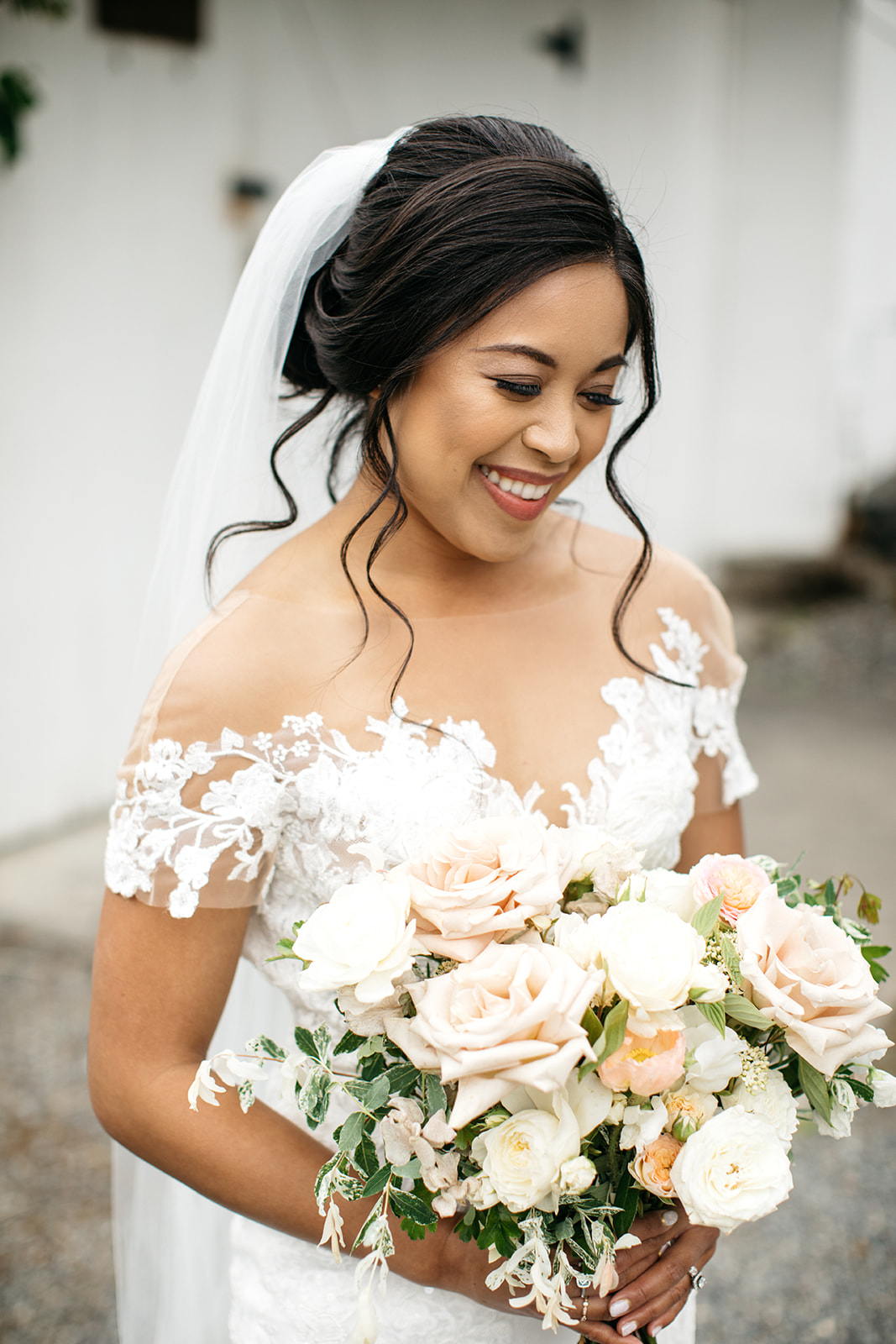 wedding hair and wedding make up - spring bride in a romantic wedding dress - holding a spring floral bouquet - image from www.emmasedition.com